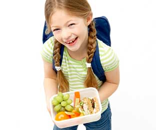 Smiling girl with her school lunch