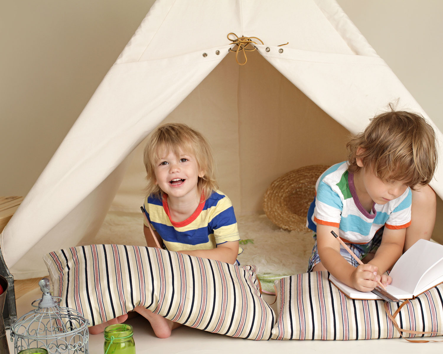 Kids with tent indoors