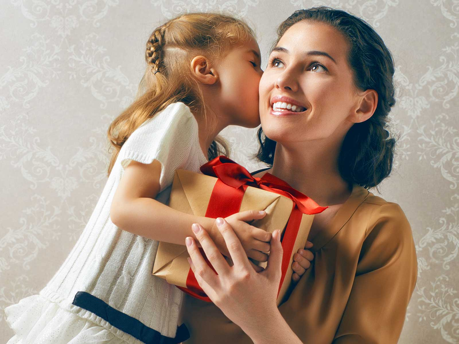 Child giving gift to mother.