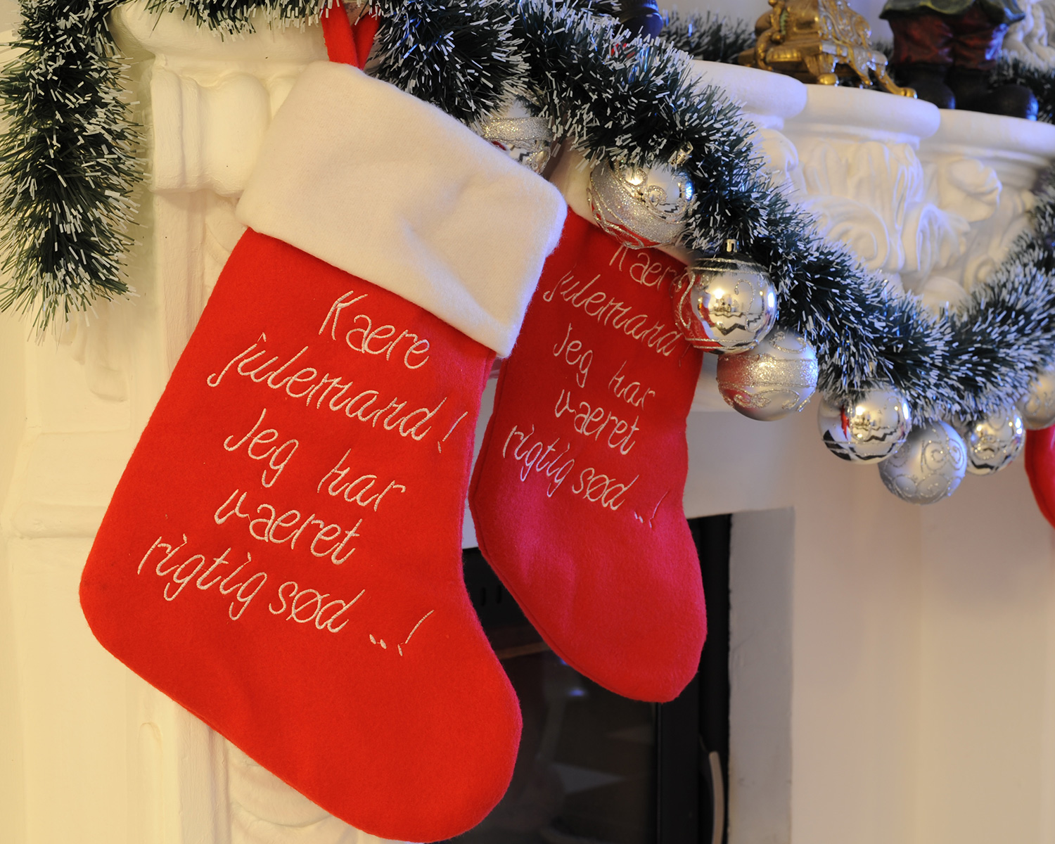 Christmas stockings from Lakeside hung from mantel