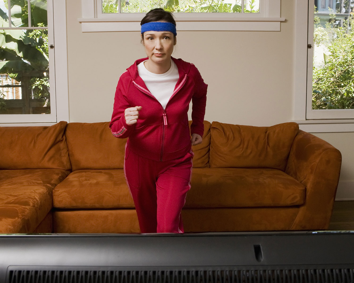Woman exercising while watching television.